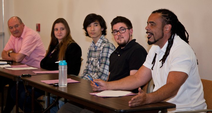 Photo from one of our community panels, featuring two professors and fellow college students.