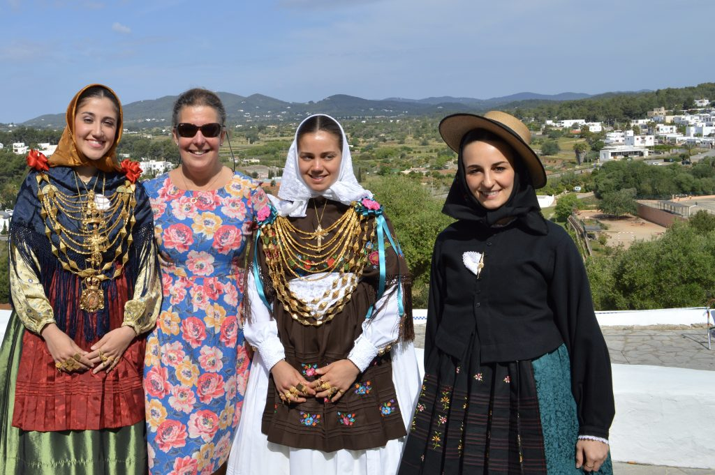 Petra with traditionally dressed ladies at the May fiesta