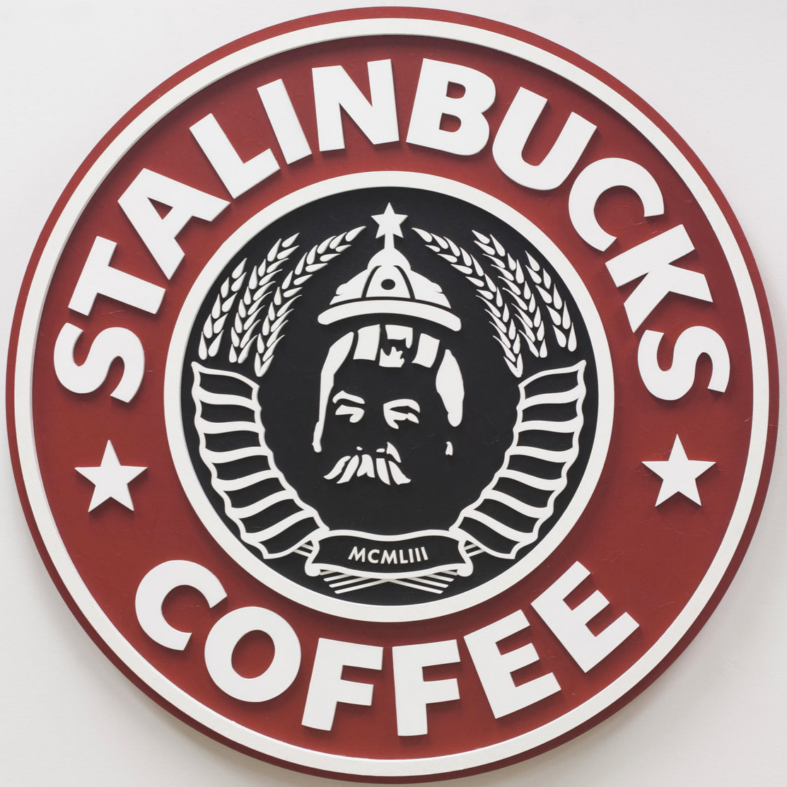 Stalinbucks (2012)    Stalinbucks  reinterprets a familiar American brand in the form of a Russian and Soviet political and nationalist symbol. Yet, as much as this parody is meant to manifest a sense of unease, it also satirizes similarities between commercial marketing and messaging, and political propaganda.