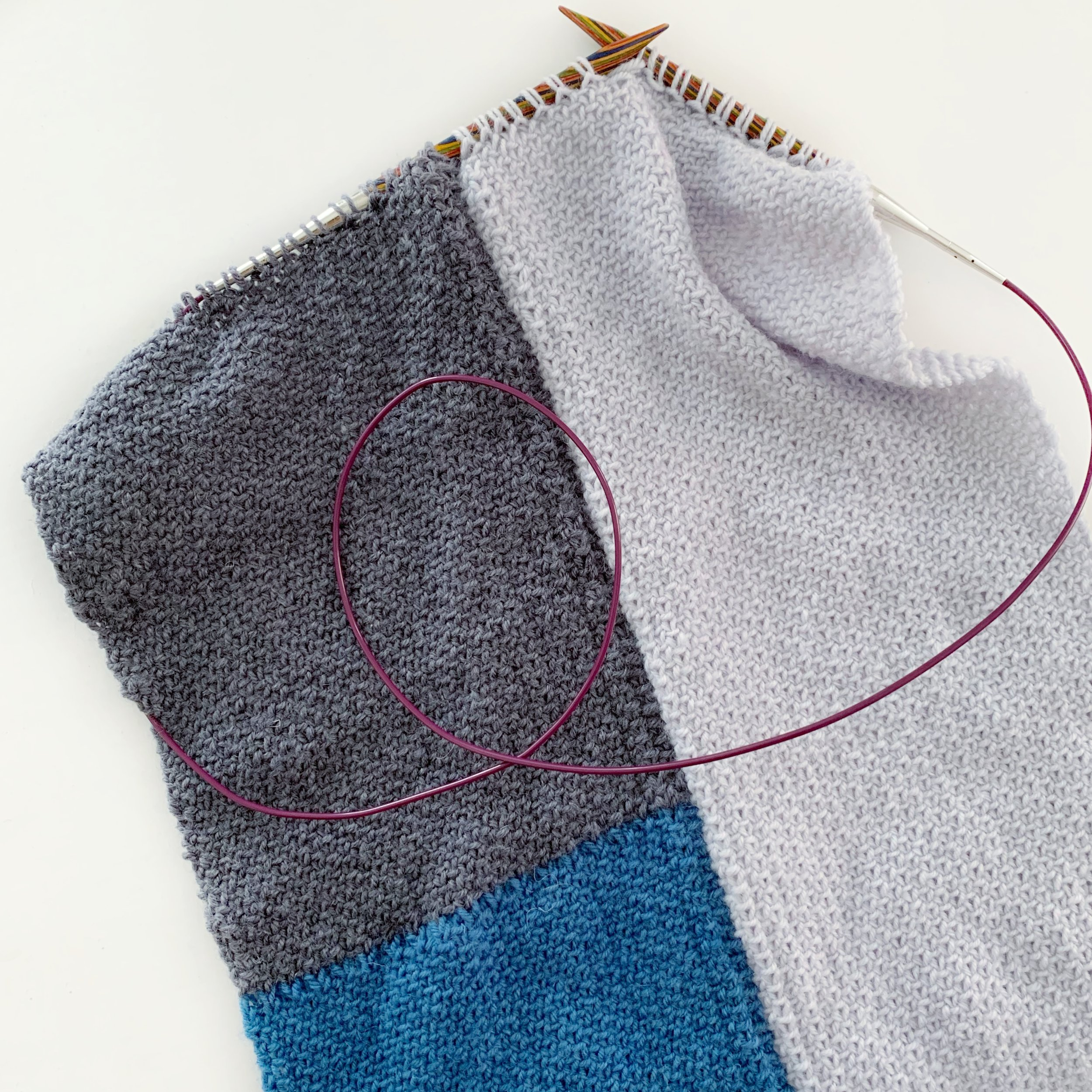Knitting a flat scarf on circular needles.