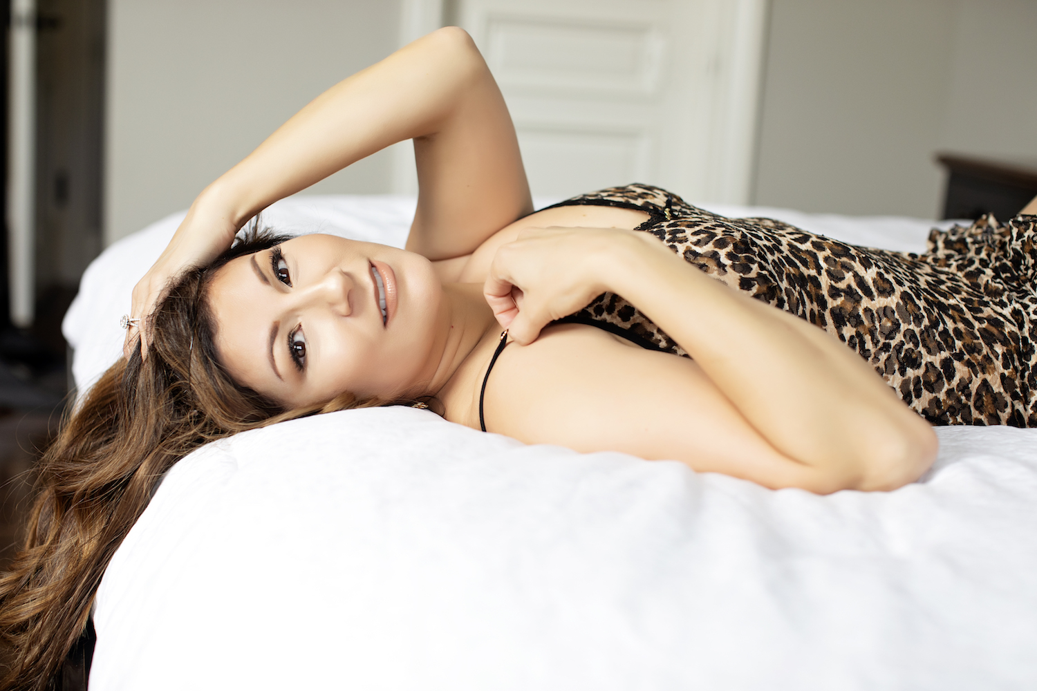Close up view of a woman wearing leopard print lingerie for a boudoir session.