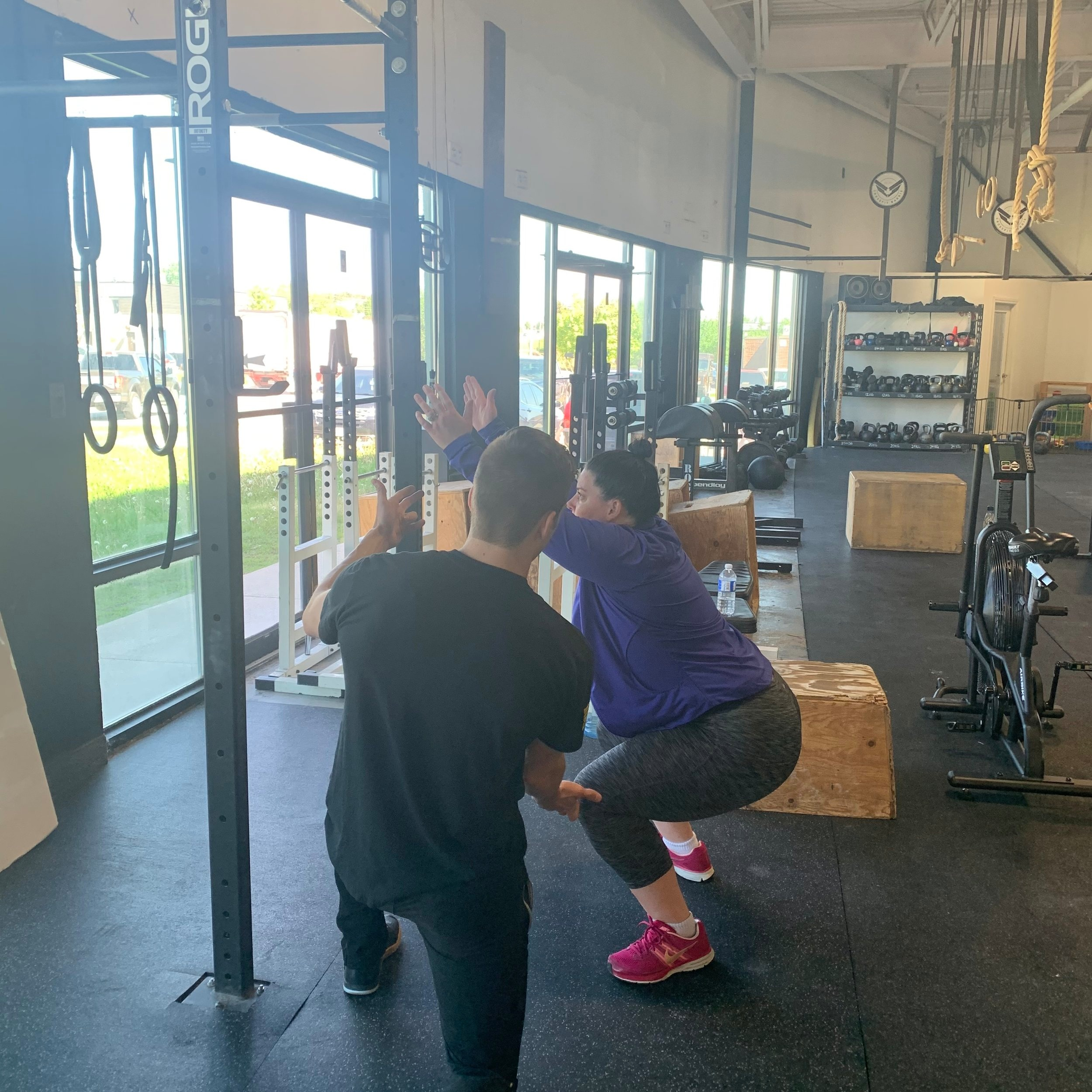 Coach Chase helping Mandy in session 1