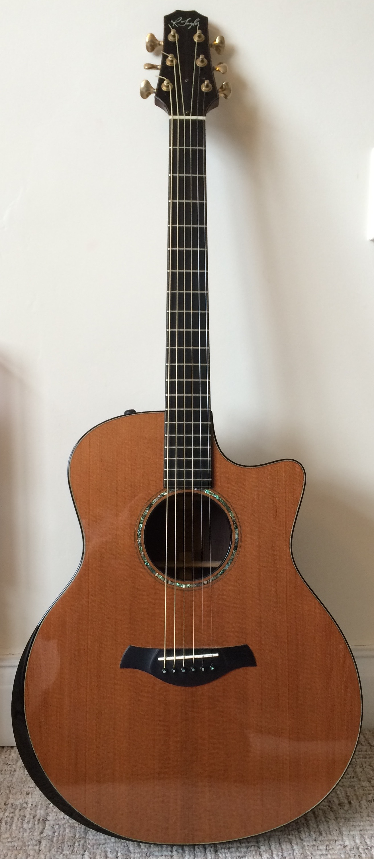 "R. TAYLOR - A.J has a R. Taylor Style 1 (2007) with redwood top, indian rosewood back and sides and a venetian cutaway. The Style One is the same size as the Taylor Grand Symphony, but with several significant structural differences. It has a 16 inch lower bought and is built with a modified X brace, 65' radius to the top and a 25 1/2"" scale length. It is fitted with the standard Taylor Expression System pickup which was fitted after purchase.The headstock is fitted with a Taylor bone nut, brushed gold Gotoh 510 tuners and black ebony look buttons which lower weight. There is a wave compensated bone saddle, plus ebony pins with abalone dots at the bridge.Unlike standard Taylor's the R.Taylor has solid kerfing which results in extremely rigid sides allowing the top to be made thinner and braced lighter. Done by hand the result is more volume and better tone.R.Taylor was a completely separate company from Taylor guitars. Their guitars took about three times as long to make due to extensive individual voicing and handwork.Unfortunately they turned out to be in competition with Taylor's Build To Order and custom guitar programs and they ceased production at the end of 2011. R.Taylor only made about 200 guitars a year for six years. This is in contrast to the two Taylor factories which turn out about 400 guitars per day."