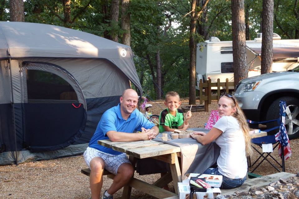 Families camping in a tent in Tall Pines Campground
