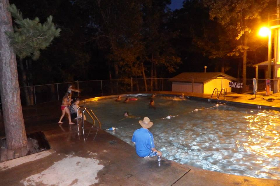 Campers using the large, clean pool at Tall Pines Campground.