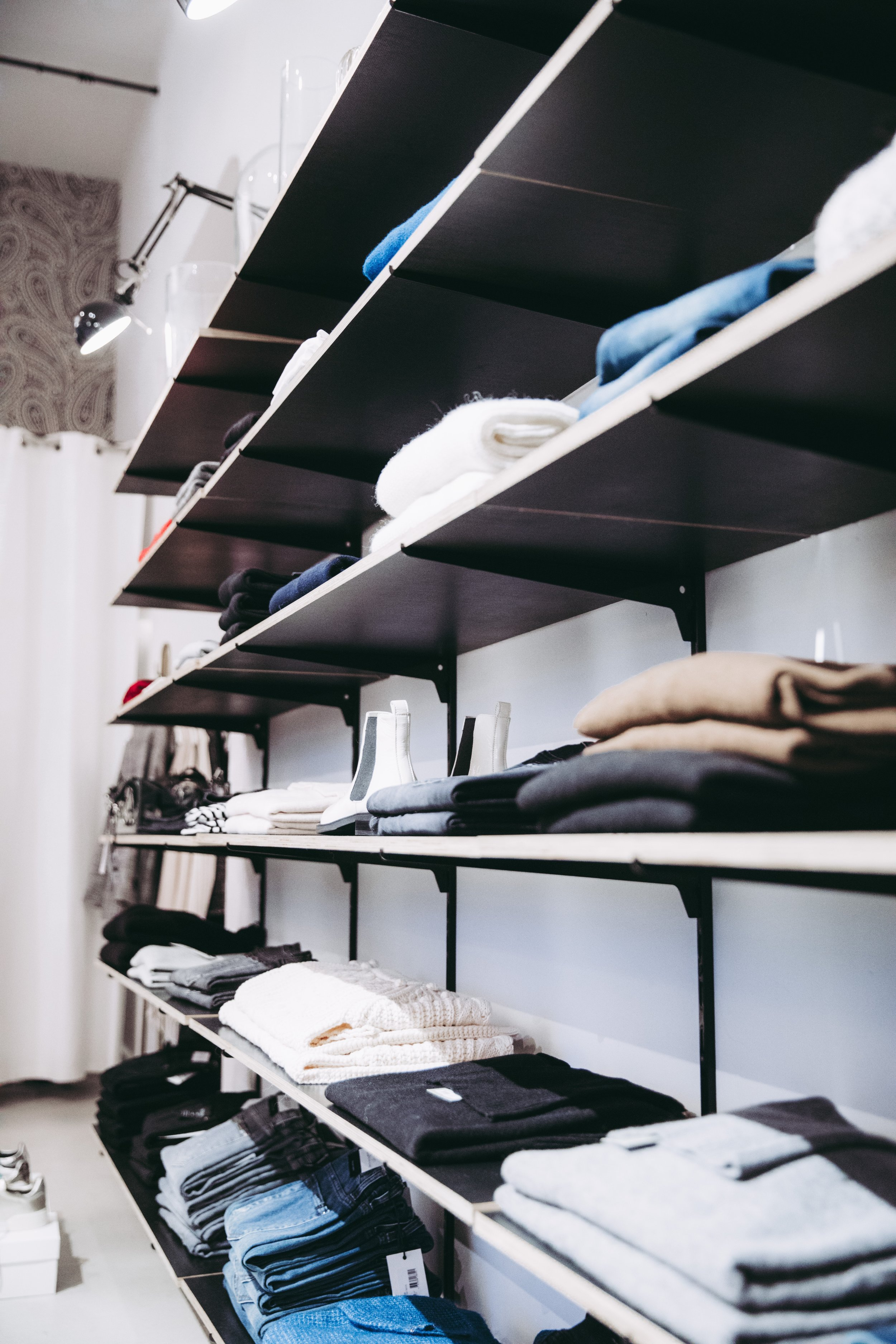 Clothes on shelves. AND, SWIPE RIGHT - Profile Styling Service: A Styling Appointment. We style our clients with outfits for upcoming dates, the dating profile photoshoot, and big event evenings.