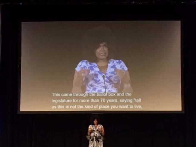 """Walidah Imarisha delivering the opening keynote  """"Why Aren't There More Black People in Oregon? A Hidden History"""" , NCORE Conference, 2019."""