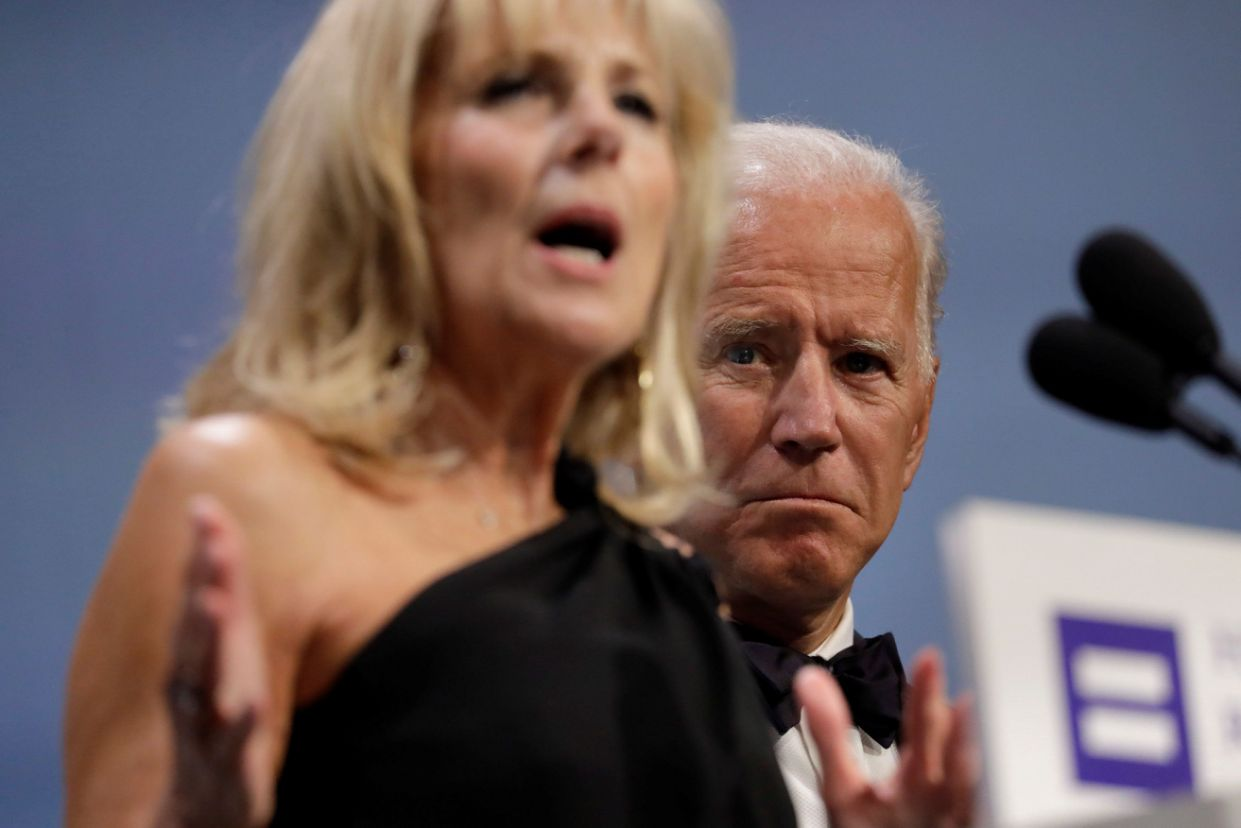 Former Vice President Joe Biden listens to his wife, Jill, during an address last year. (Yuri Gripas/Reuters)