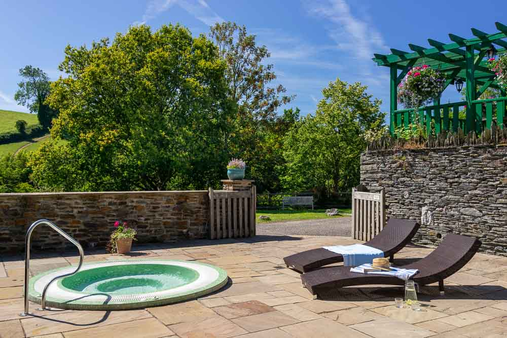 The south facing sun terrace at Flear Farm COttages has sun loungers and a wonderfully warm hot tub, perfect for relaxing on a sunny day, or even warming up after a chilly winter walk.