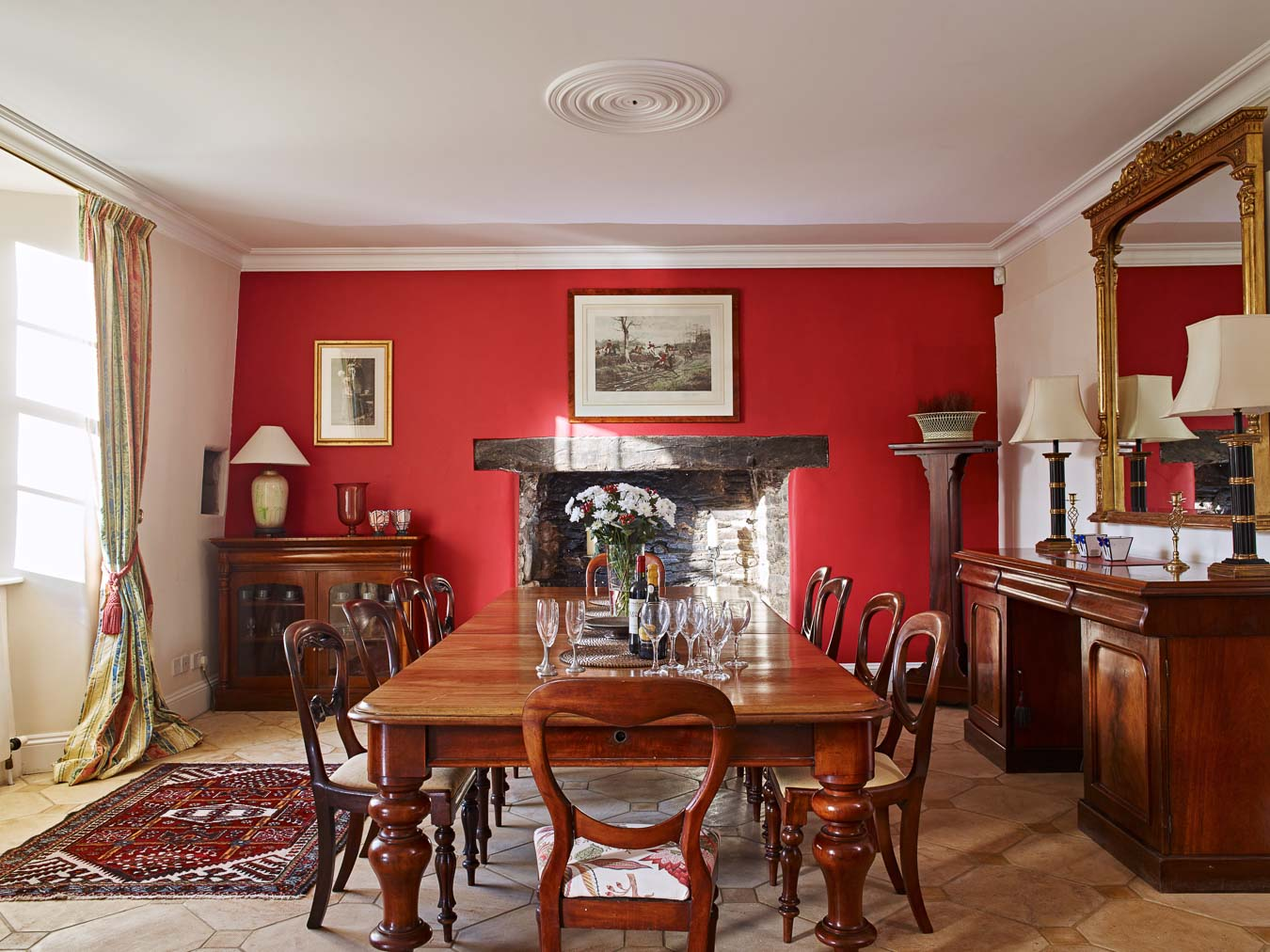 The grand Red dining room of Flear House at Flear Farm.
