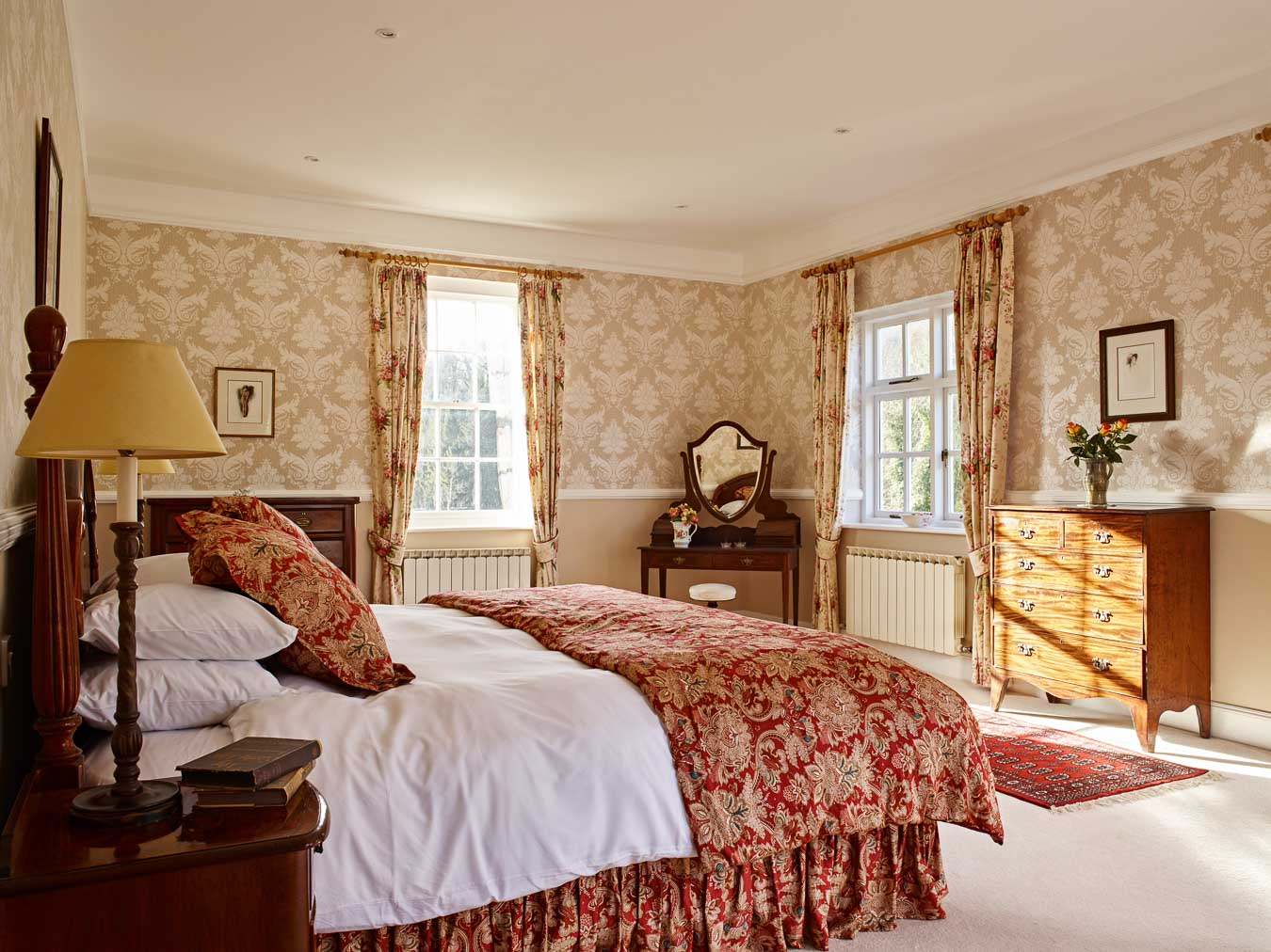 The grand master bedroom with its Super King size bed and triple aspect views in Flear House.