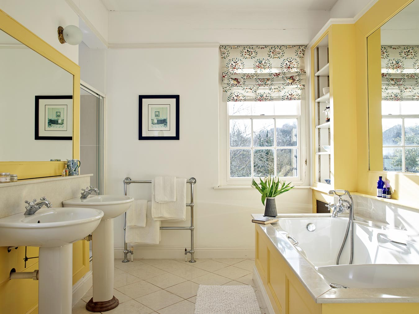 The bright master bathroom in Flear House with walk in shower, double sinks and jacuzzi bath.