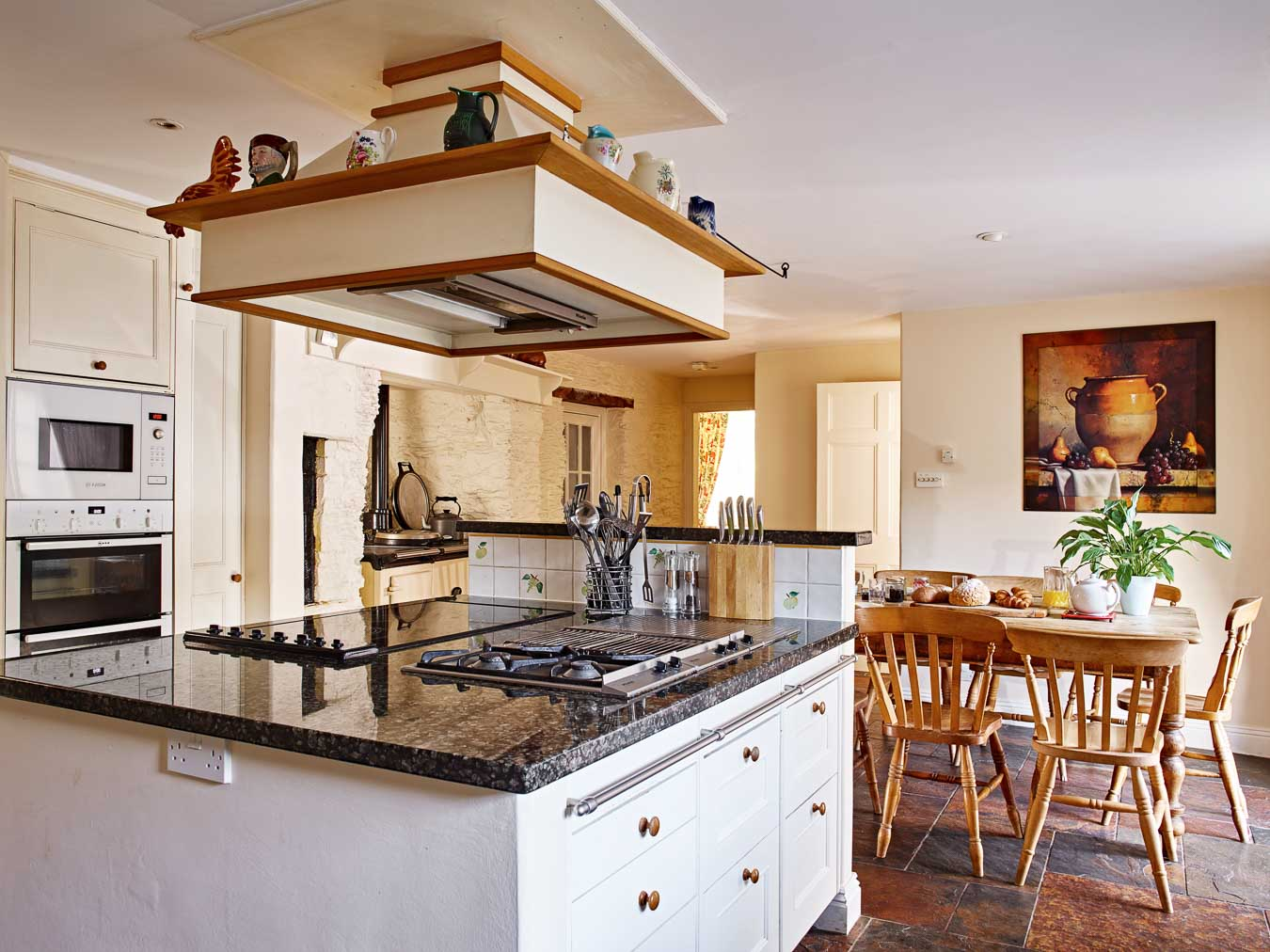 Flear House kitchen with is oven stack, electric hobs and gas burner.