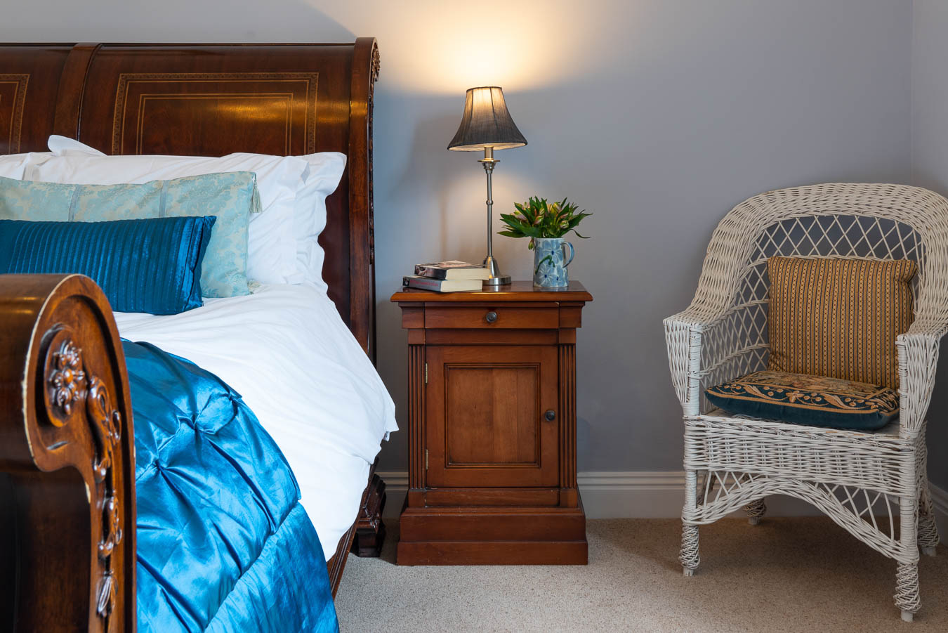 Mahogany bedside table and sleigh kingsize bed in the Blue room in Flear House.