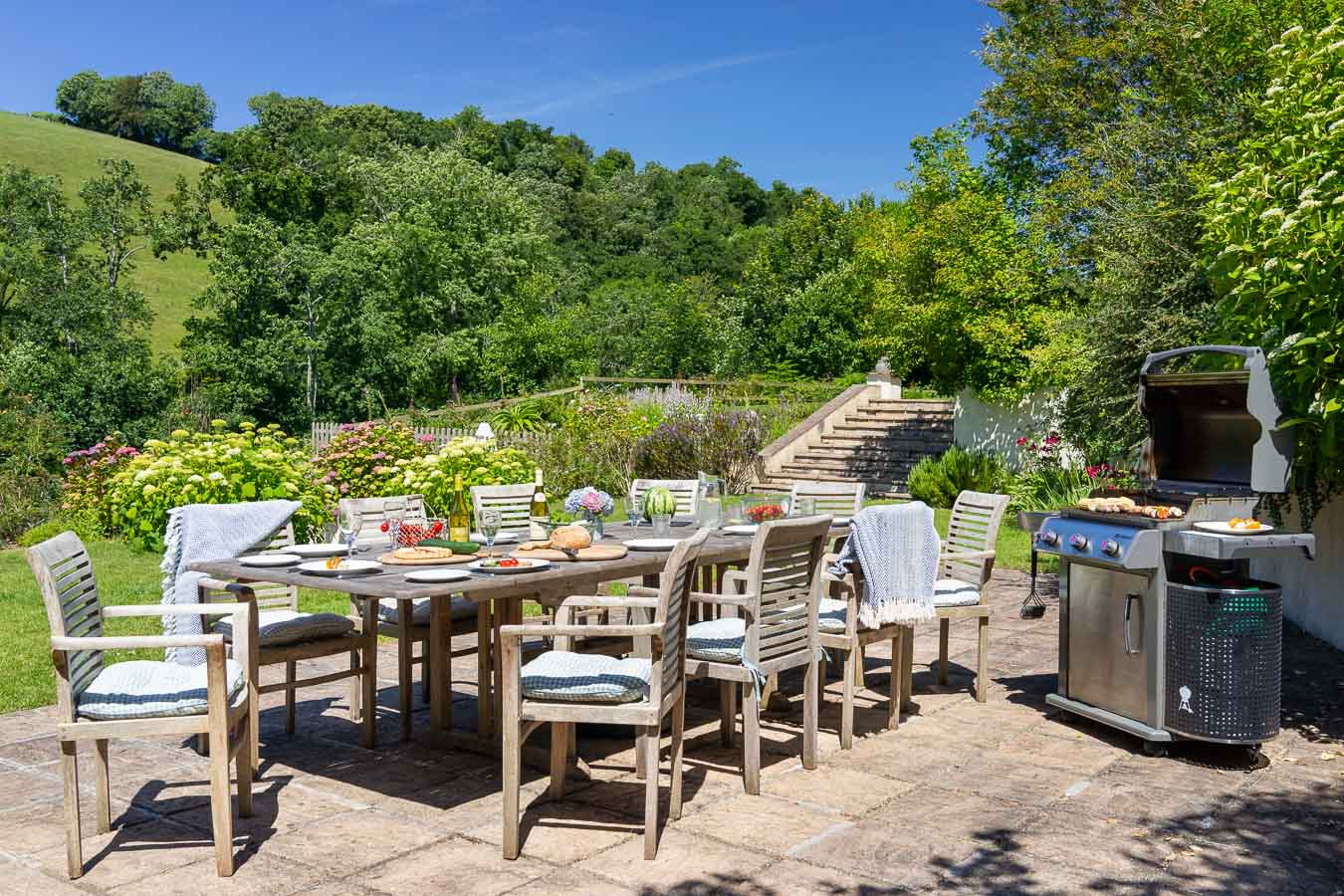 BBQ terrace and 3 burner gas BBQ set in the mature and large garden of Flear House.