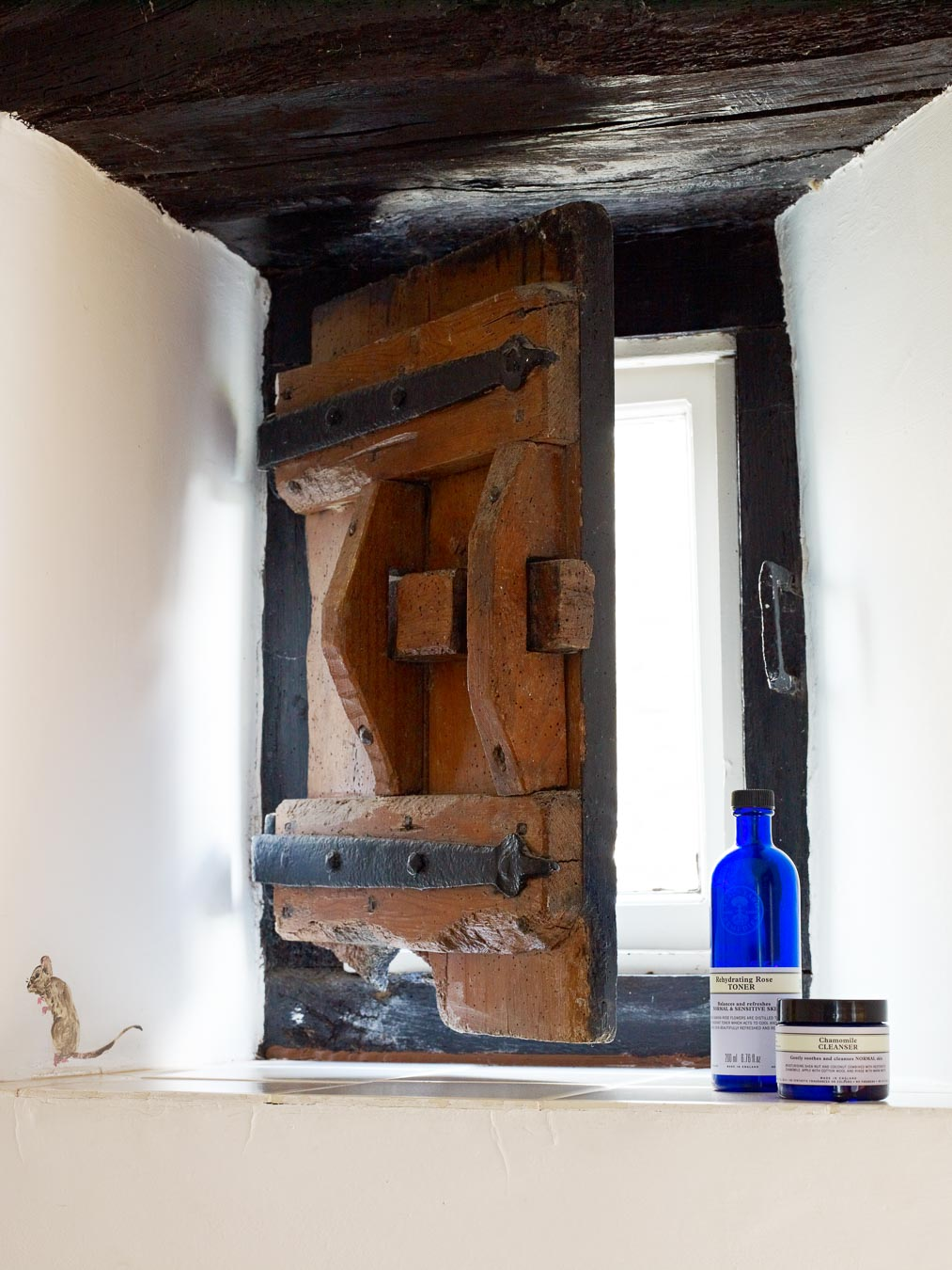 The original wooden shutter in the family bathroom in 1843 cottage Flear Farm.