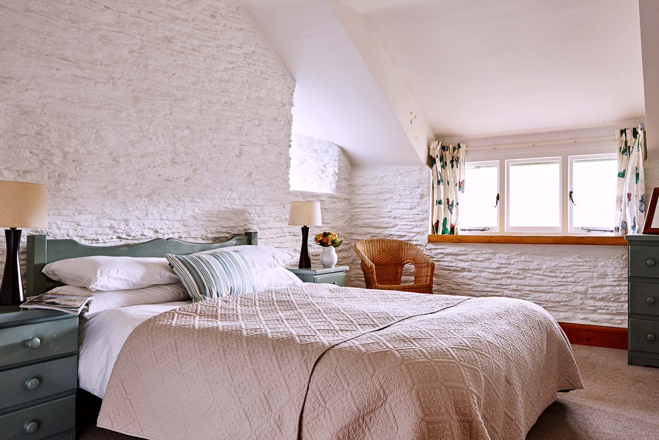 The large master bedroom in Quarry Cottage at Fiear Farm. With Kingsize bed and built in wardrobes the windows overlook the trees and valley beyond.
