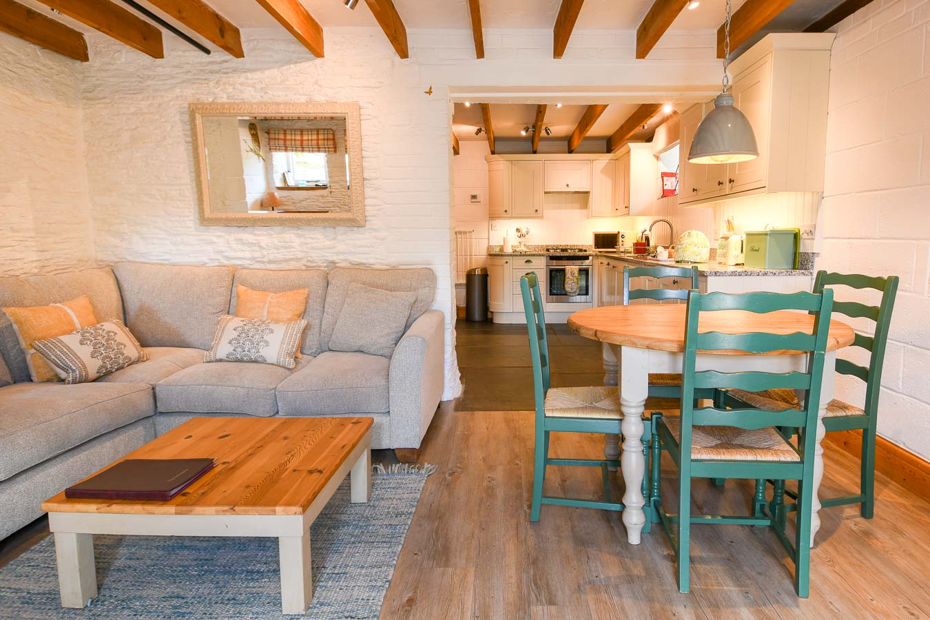 Detail of the corner sofa and open plan living room in Quarry holiday cottage Flear Farm.