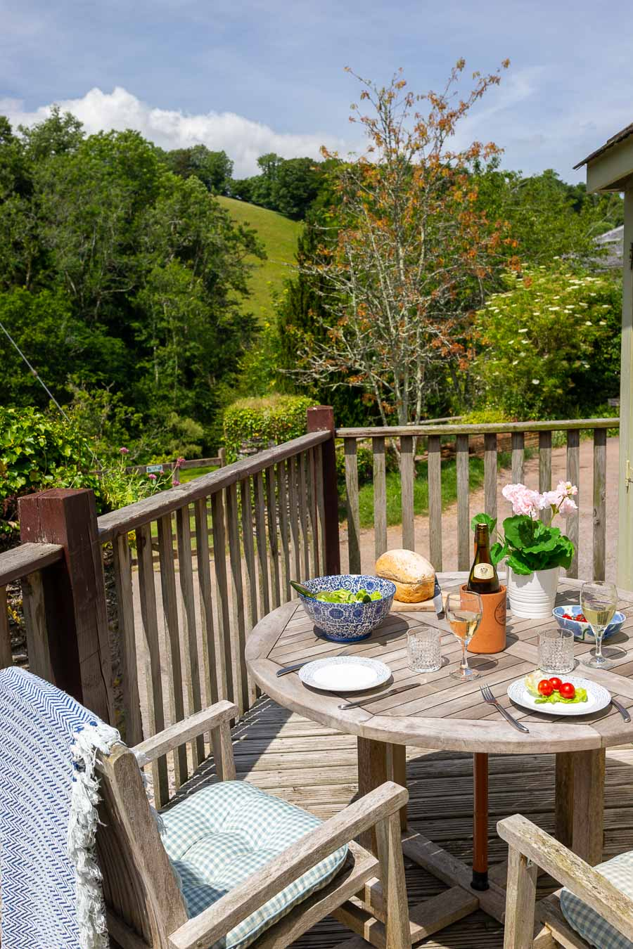 The private deck at Dairy cottage, for sunny lunches or romantic evening meals overlooking the duck pond and tree lined valley of Flear Farm.