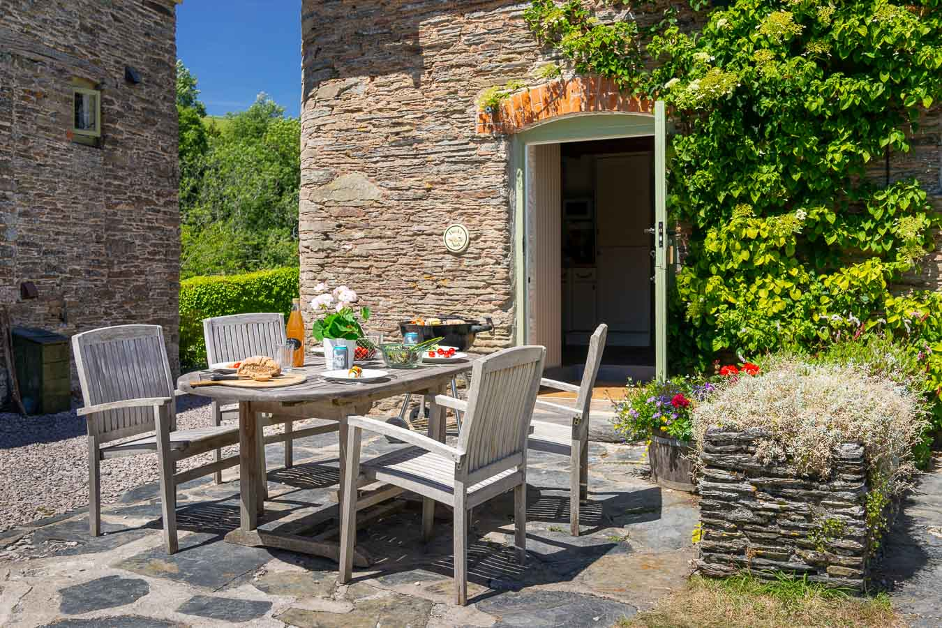 Alfresco dining on private patio outside Duck's Nest cottage Flear Farm.