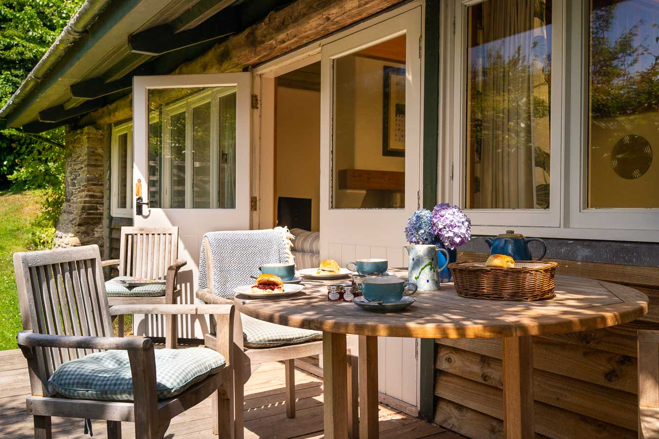 The west facing private decking situated in the Linhay cottage's garden just off the open plan living room. Complete with teak garden furniture at Flear Farm cottages.