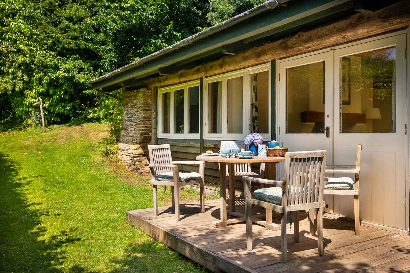 The small west facing garden with sun deck and garden furniture The Linhay cottage Flear Farm.