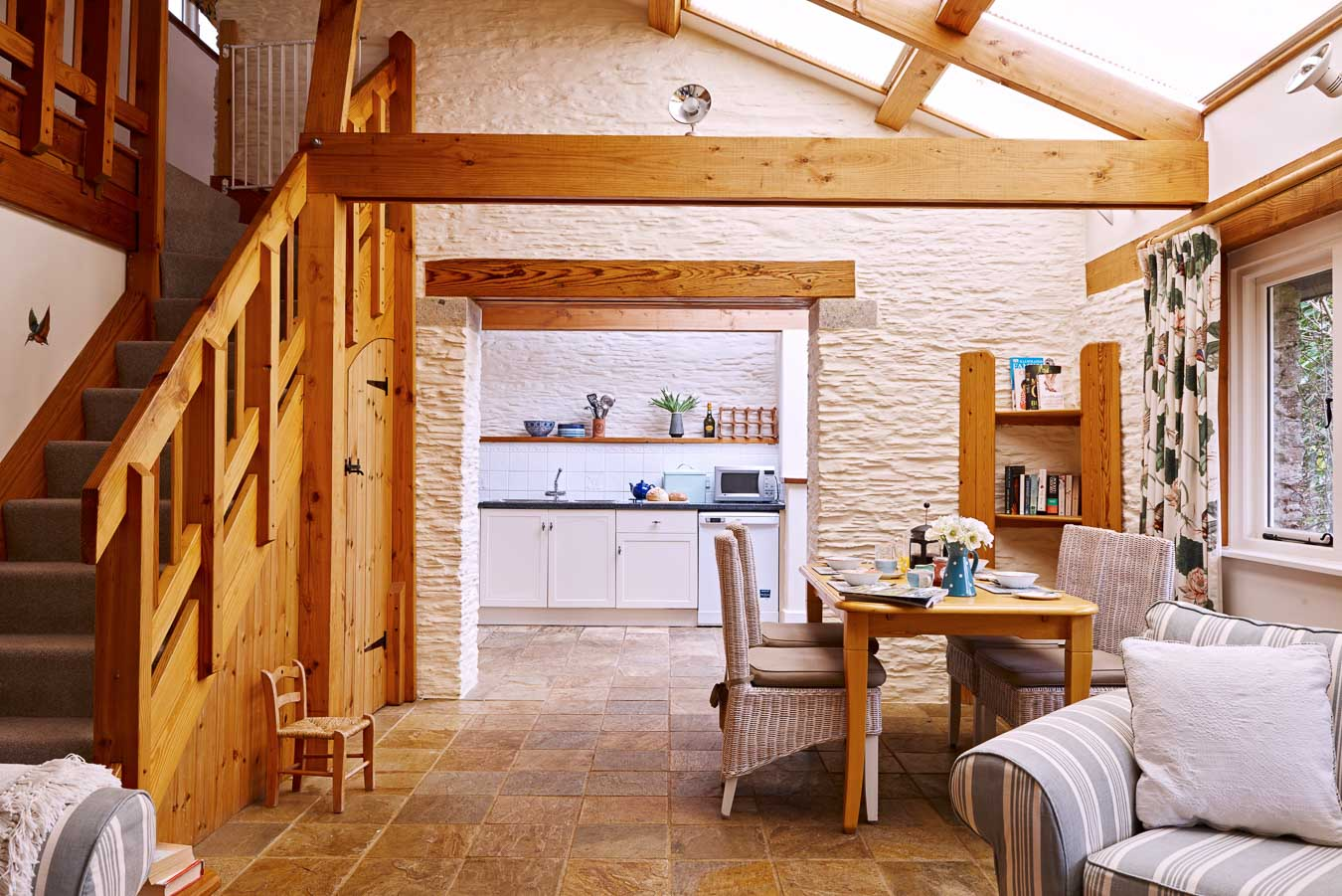 Open plan living room, dining area and kitchen in The Linhay cottage Flear Farm.