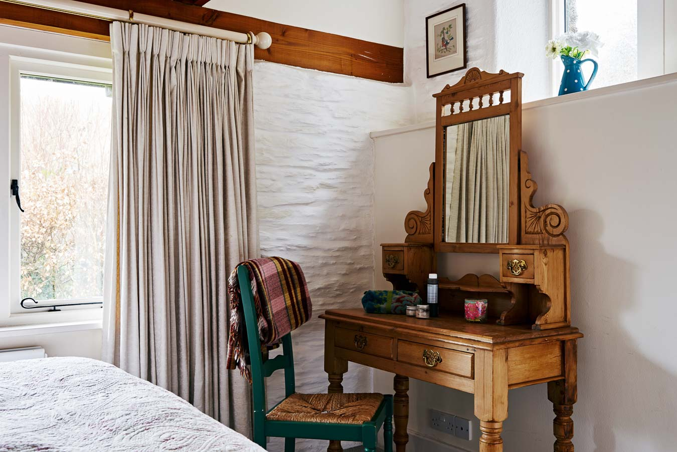 The Linhay's master bedroom dressing table and large windows looking into private garden at Flear Farm.