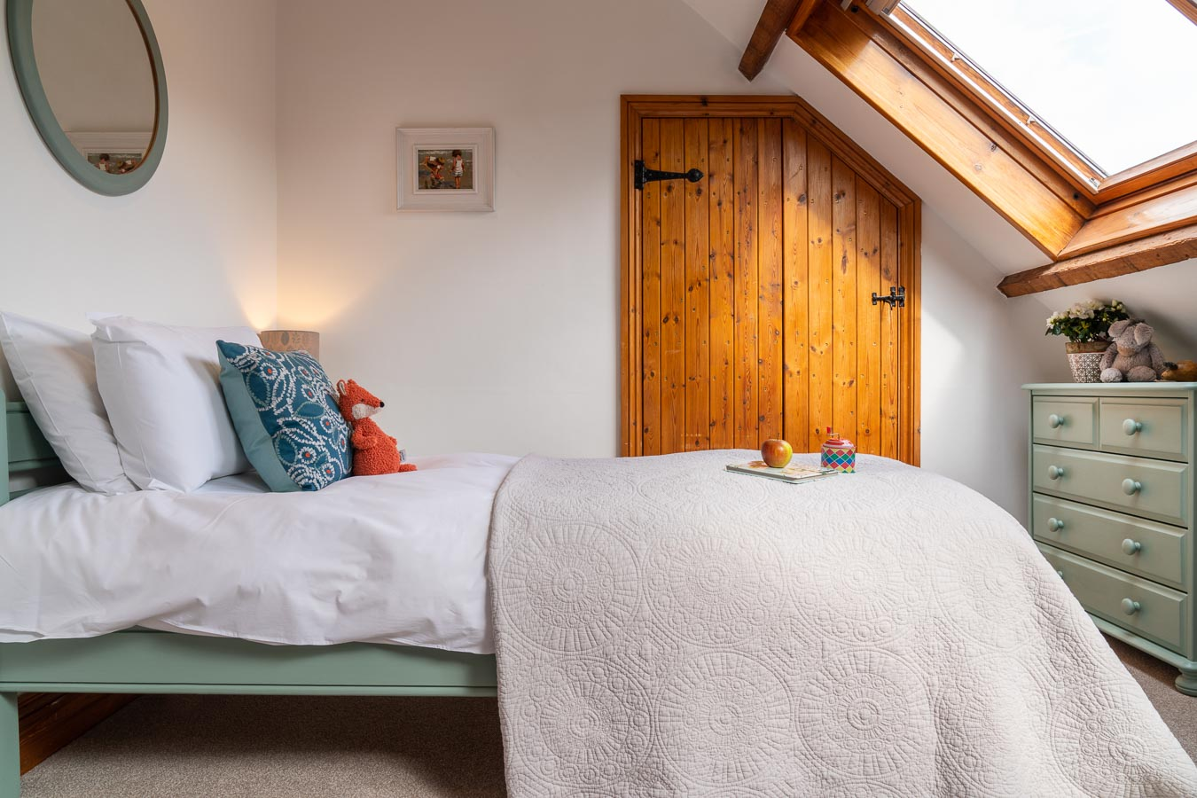The twin bedroom with duck egg colour scheme and 100% Egyptian cotton bedding. Mangers Cottage, Flear Farm Holiday Cottages Devon.