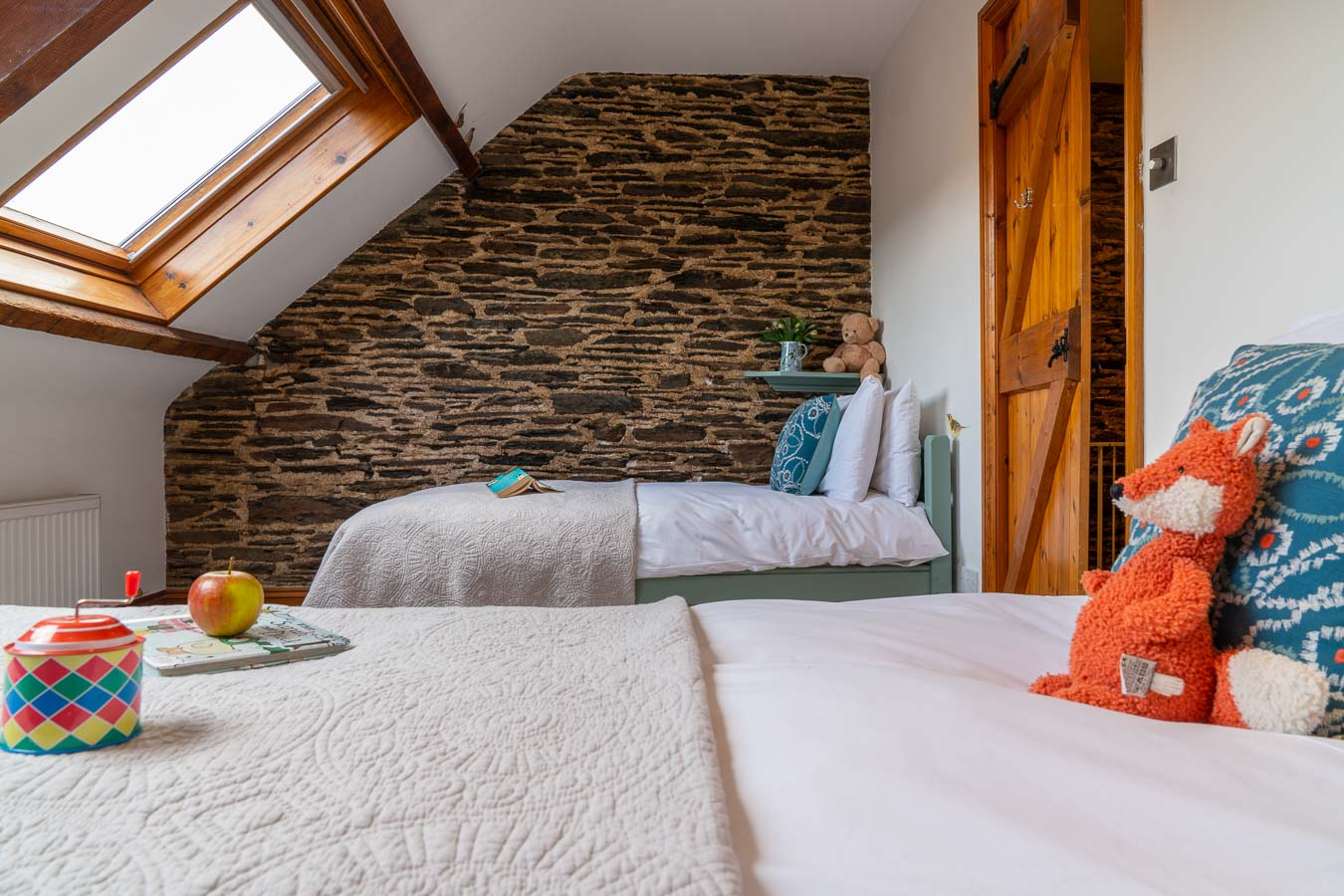 he twin bedroom with duck egg colour scheme and 100% Egyptian cotton bedding. Mangers Cottage, Flear Farm Holiday Cottages Devon.