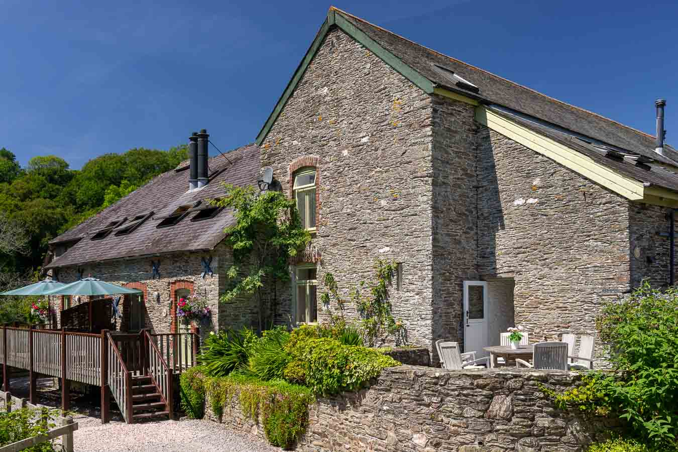 The beautiful stone buildings of Flear Farm holiday cottages. With sun terraces and mature gardens.