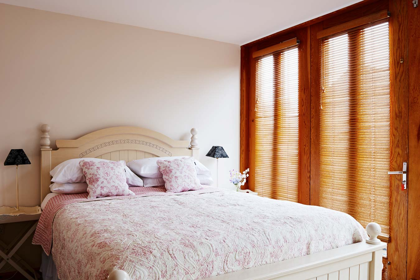 King size bedroom in Orchard Lodge At Flear Farm with ample built in storage, large windows and en suite.