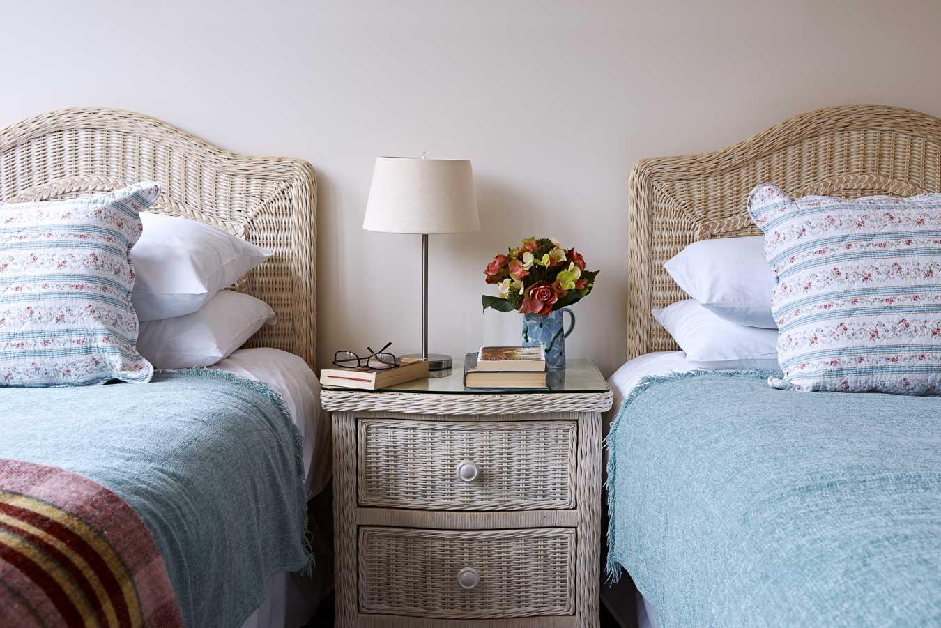 Orchard Lodge's twin room. Rattan style divan beds with 100% Egyptian cotton bedding.