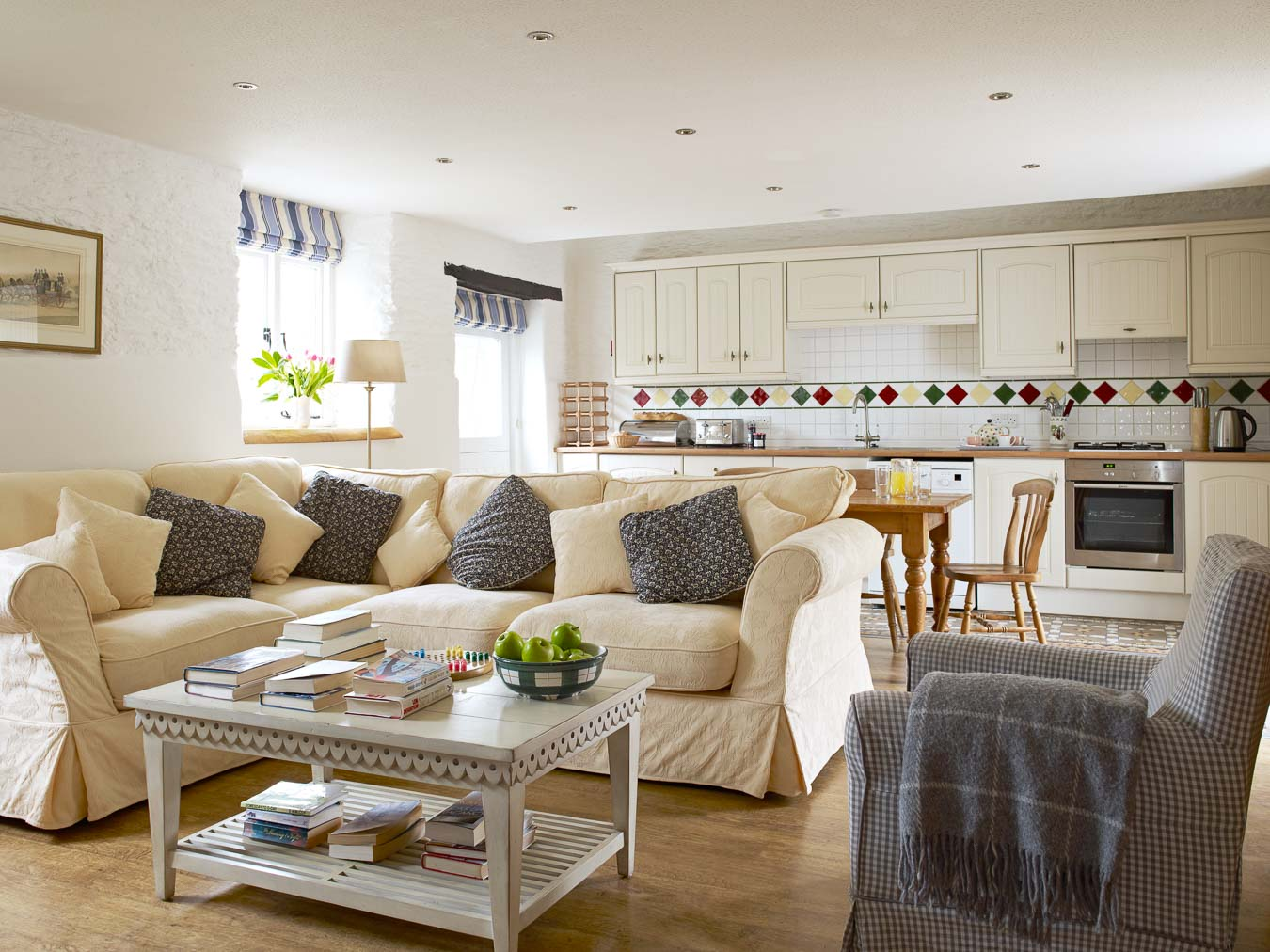 Stables cottage is light and airy and has open plan down stairs. With soft yellow corner sofa and large farmhouse table to seat six this space is perfect for all the family.