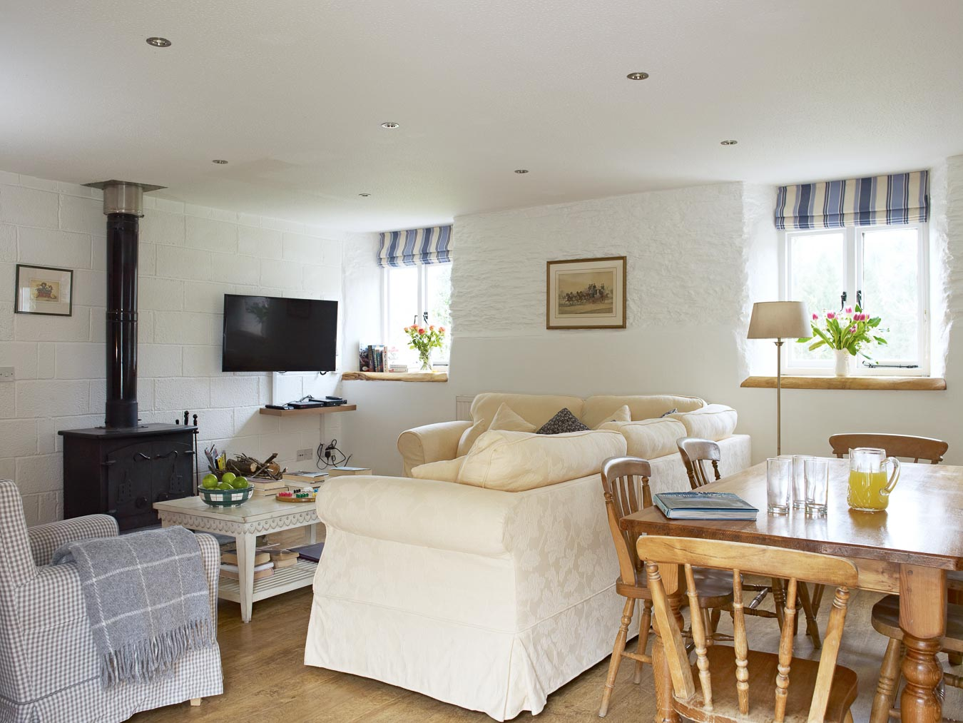 A log burning stove and comfortable sofa make this cottage perfect for all weathers. The Stables Cottage at Flear Farm.