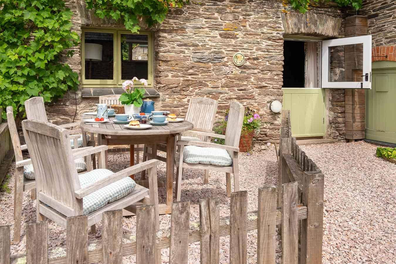 Original stone work and stable door make the Stalls cottage a wonderful holiday home at Flear Farm, Devon.
