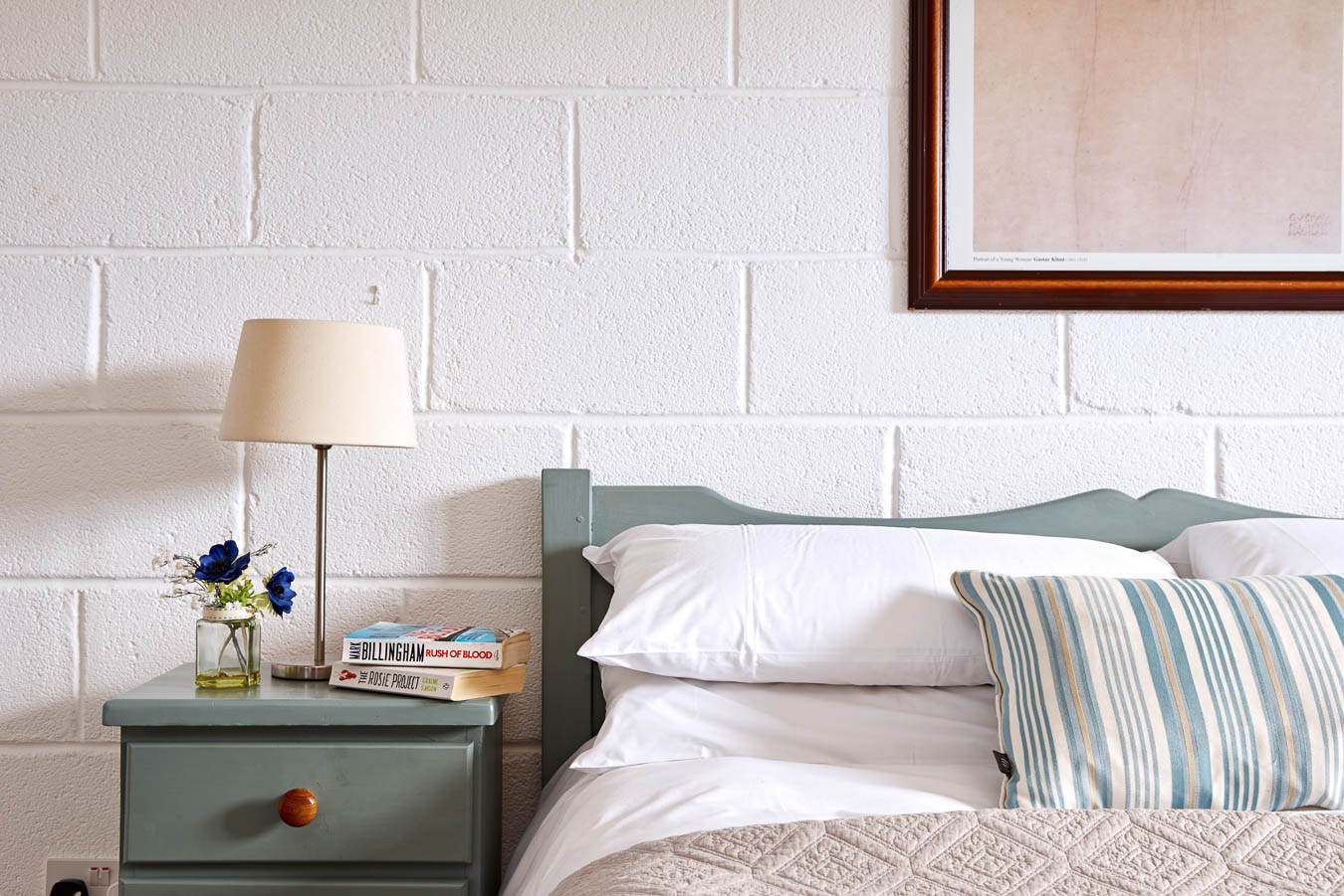 Stylish and Duck egg with white washed walls. The King size master bedroom in The Stalls Cottage, Flear Farm holiday cottage.