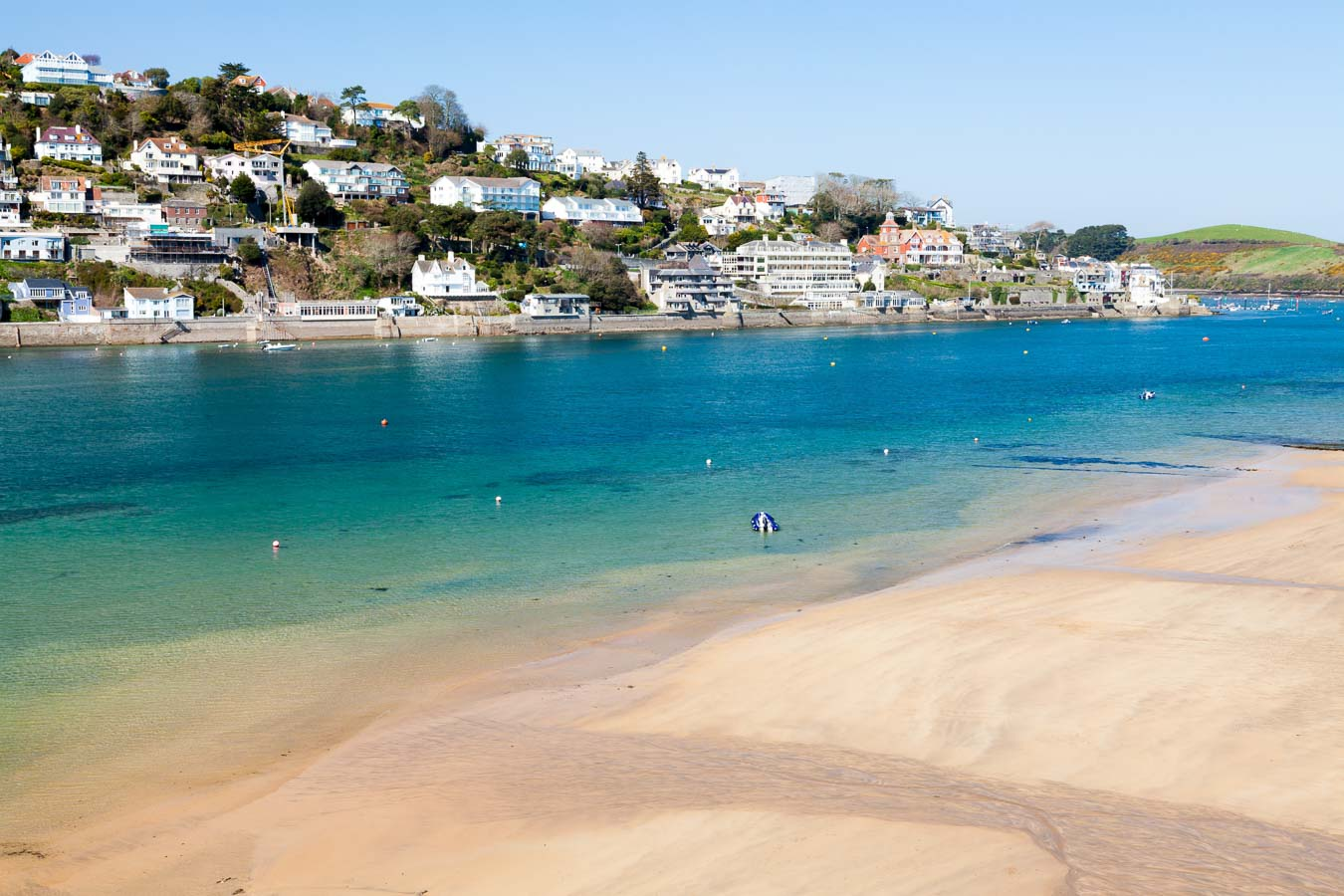 The shore line of Mill Bay looking towards Salcombe, South Devon.