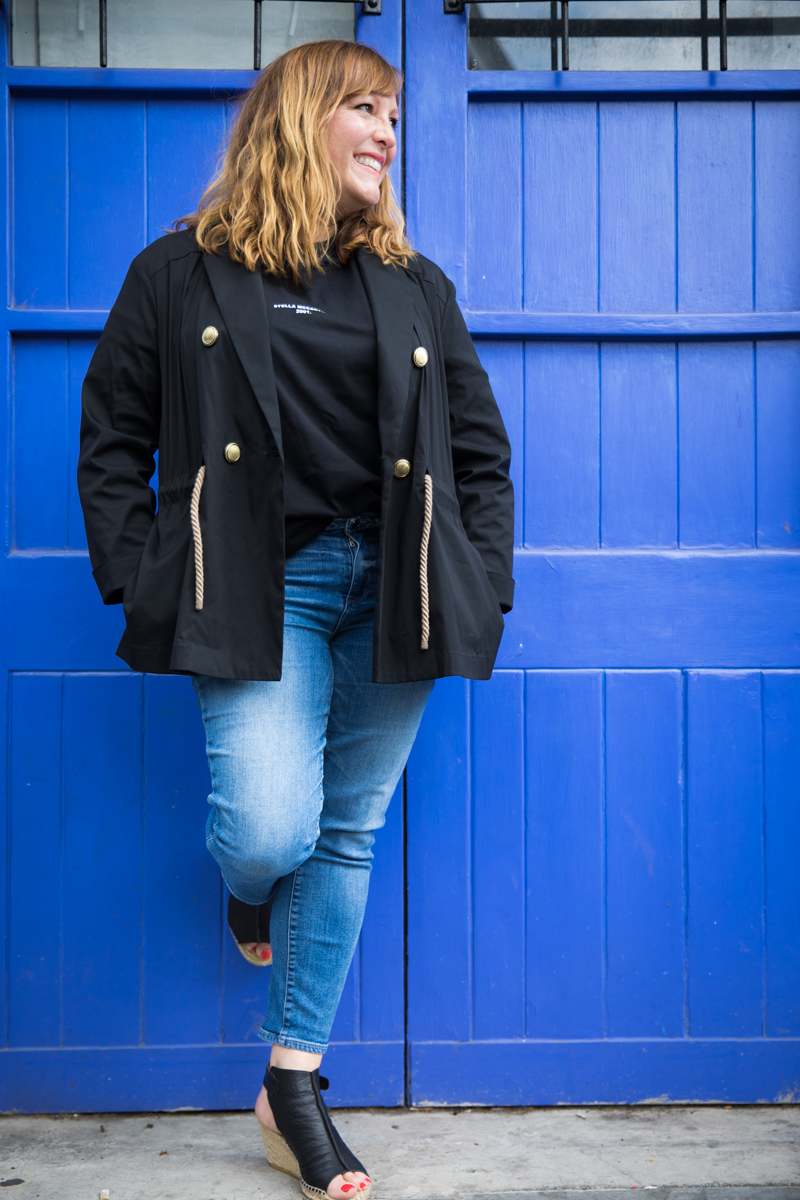 Donna Ford London Street Photography leaning against blue door on Bermondsey St