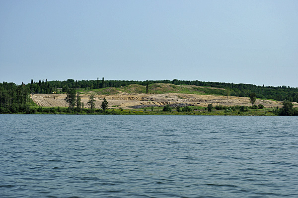 The cleared land eroding into the lake.