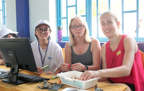 Emily Nguyen (left) and her team train for the LEGO robotics workshop. (Photo: Dan Q. Dao)