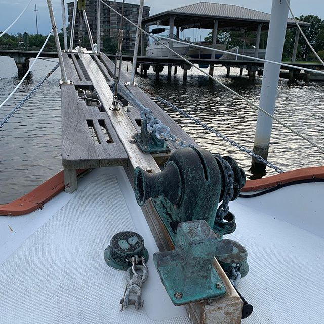 Nice evening to sit on the bow and work on the iPad. The anchor windlass really needs some love.  #tenyearplan #westsail #sailing #boatlife #westsail32 #liveaboardlife #sailboat #liveaboardlife