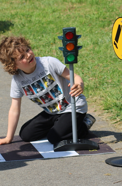 Boy Looking At Traffic Lights