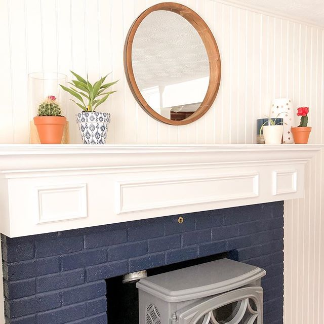 Neutral navy blue. 👩🏼‍🎨 I very rarely question a design decision, but I wavered at the first few brush strokes on our old brick fireplace... but when the paint dried and all of the finishes were in place, my vision came to life.  Swipe for the before and double tap if you love the navy blue brick as much as I do! Read about this DIY in my latest post! Link in the bio  #diy #homeimprovement #homerenovation #homedesign #interiordecor #homesweethome #livingroom #brickfireplace #homedecor