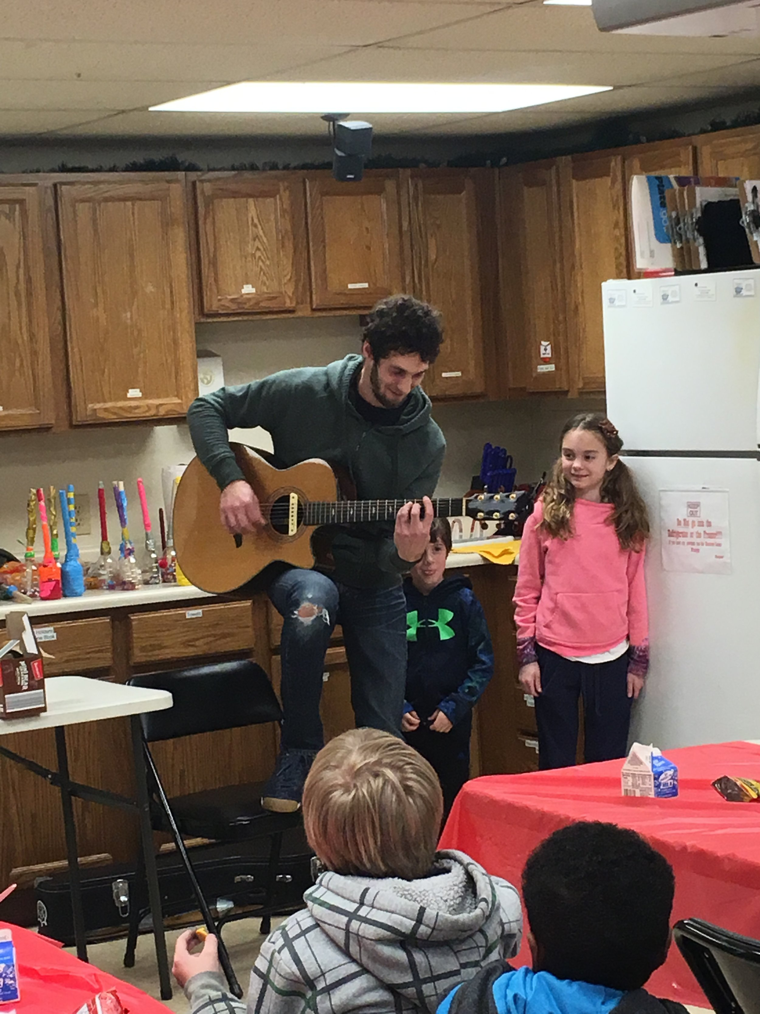 Greg and his children sharing their time and talent with our Spring Break Music Vacation in 2019.