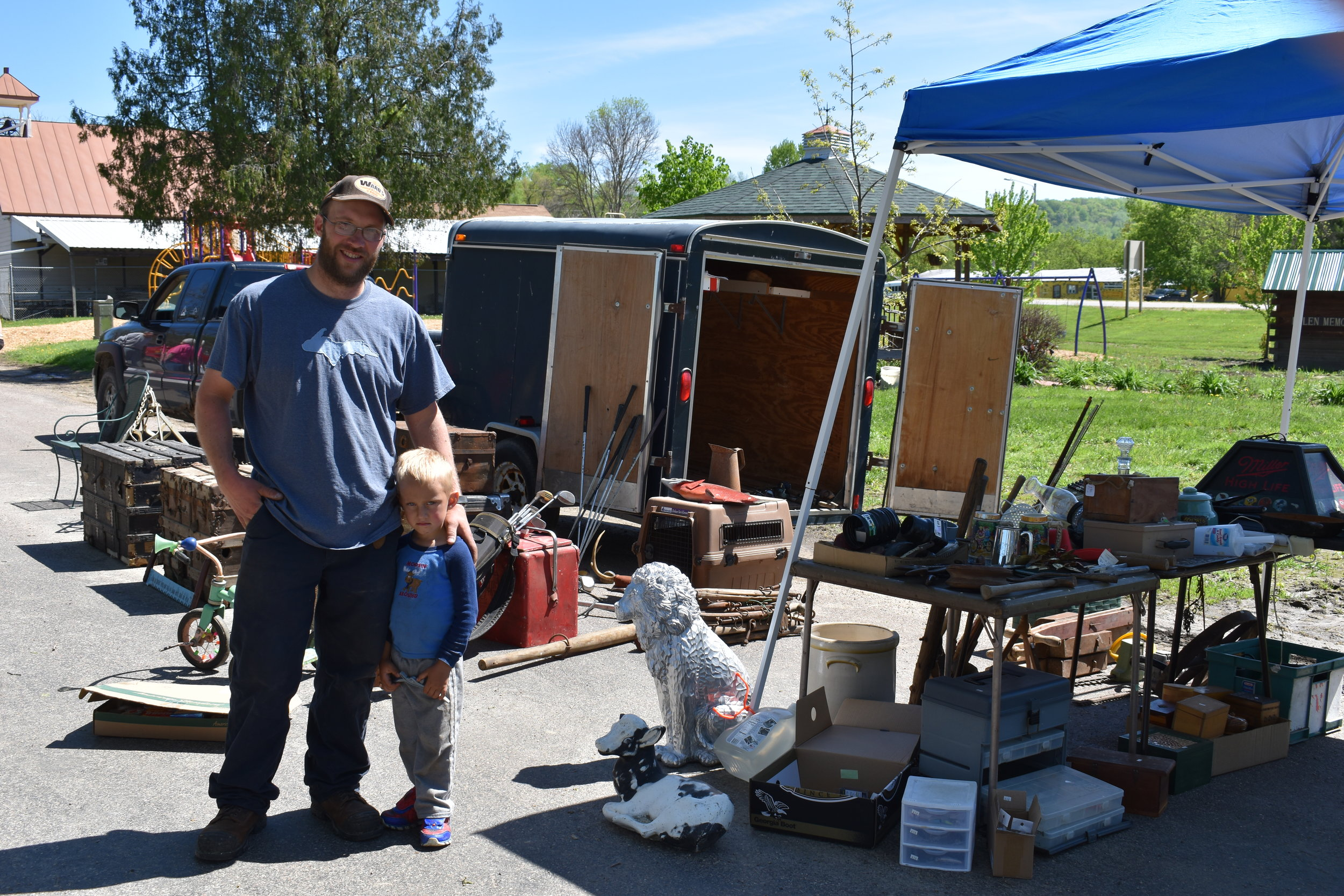 Chad Dompier and son Dale of Ontario, WI., selling vintage goods and fishing gear.