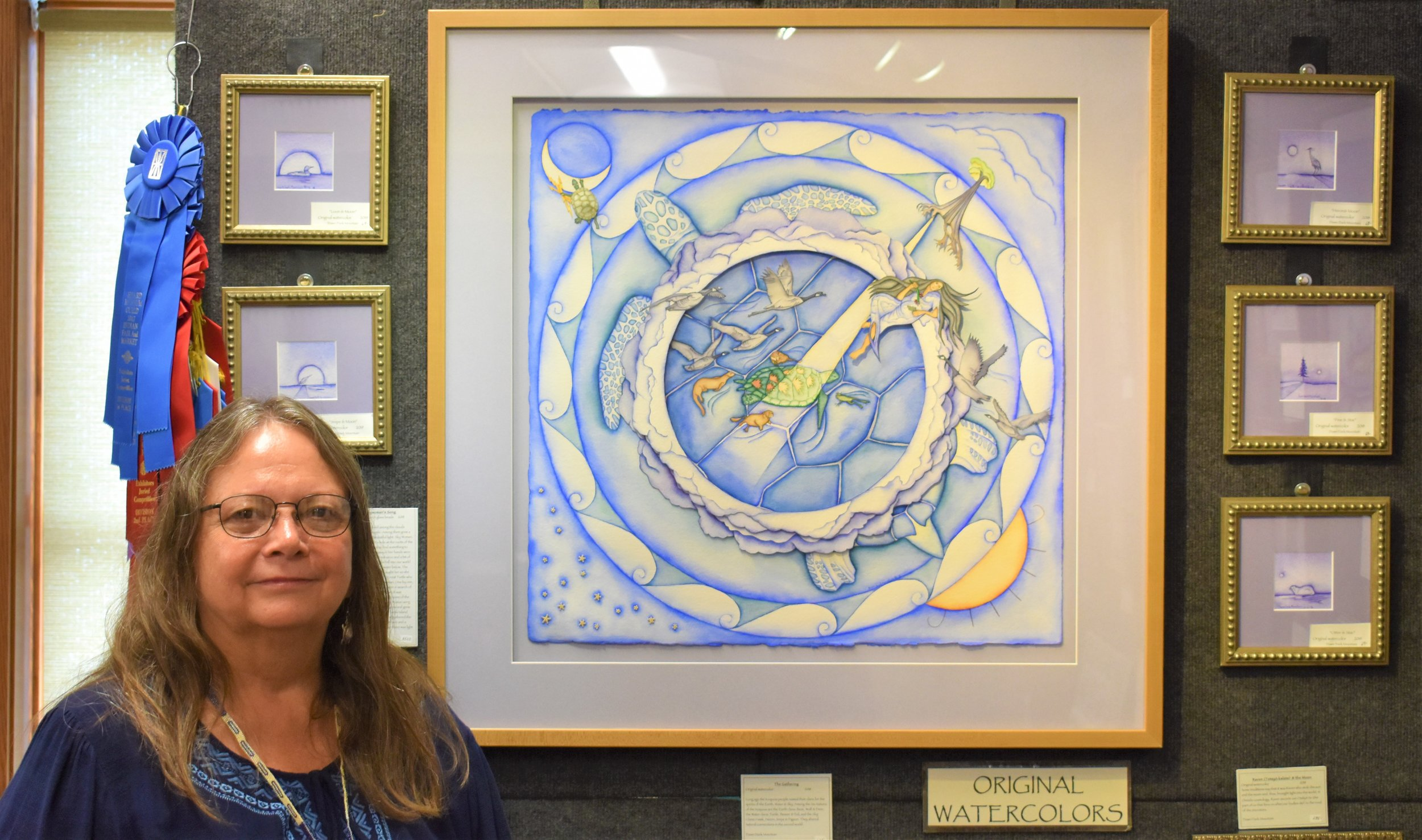Wisconsin Oneida tribal member, Dawn Dark Mountain with one of her water color pieces