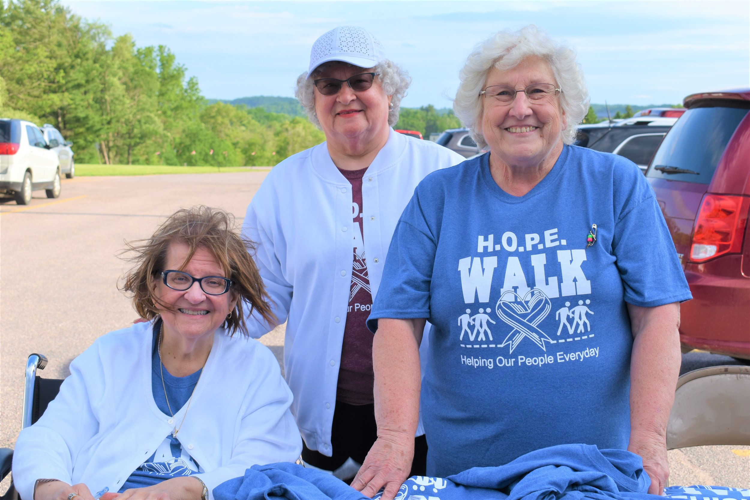 L to R- Connie Dorow, Shirley Richardson, and Jean Hora issuing T-Shirts