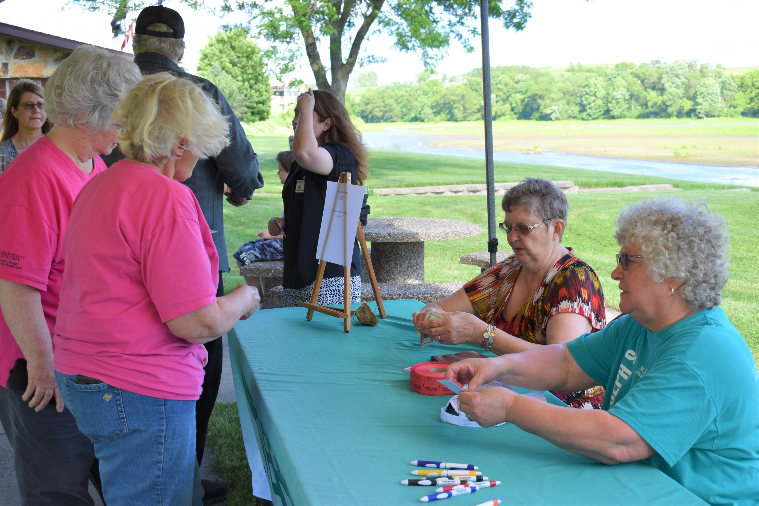 T the table L to R June Hooker and Shirley Richardson selling Tea Party tickets.