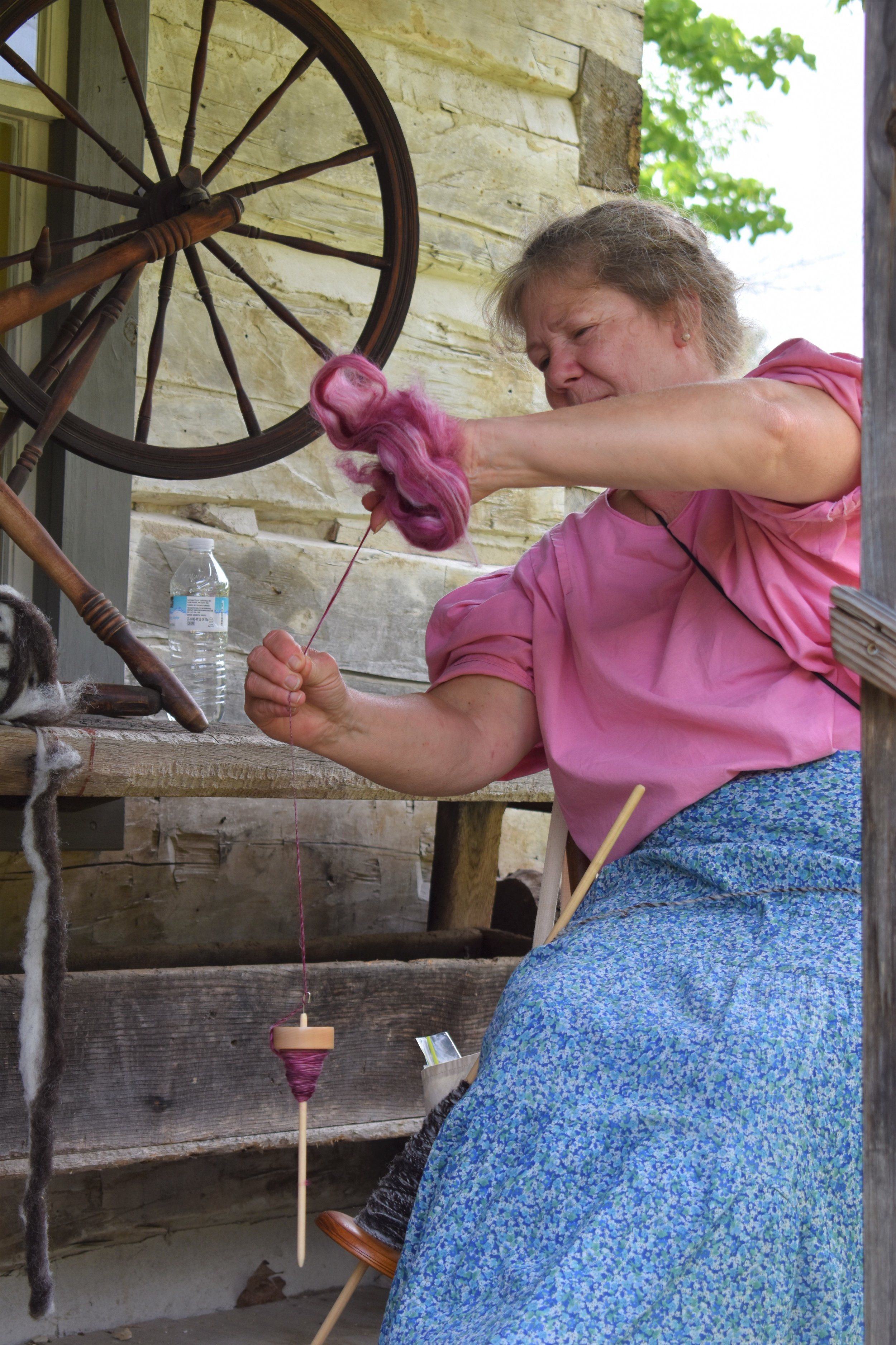 Spinning wool, Charlene Tumi of the Three Rivers Weaving and Spinning Group
